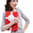 Young woman hugs a gift — Stock Photo