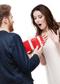 Man surprises his girlfriend with present — Stock Photo