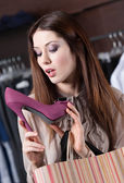 Scrutinizing elegant shoes — Stock Photo