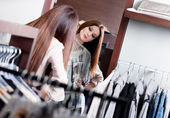 Admiring herself at the mirror while trying on a dress — Stock Photo