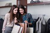 Two friends buy presents in a sale — Stock Photo