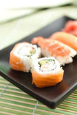 Plate with sushi, isolated on white background — Stock Photo