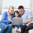 Happy family surf on the internet — Stock Photo