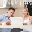Married couple with the cup of tea surfs on the internet — Stock Photo