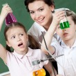 Royalty-Free Stock Photo: Little pupils wonder at the result of the chemical experiment