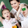 Little pupils wonder at the result of the chemical experiment — Stock Photo