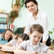 Teacher helps her pupils to do the task — Stock Photo