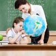 Studying geography with terrestrial globe — Stock Photo