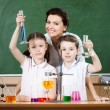 Little pupils study chemistry with their teacher — Stock Photo