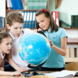 Pupils find something at the school globe — Stock Photo #12288203