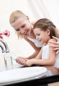 Little girl cleans teeth with her mum — Stock Photo