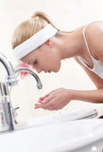 Woman washes her face — Stock Photo