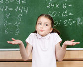 Pupil doesn't know the answer and spreads her arms — Stock Photo