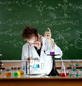 Mad professor holds an experiment — Stock Photo