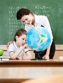Studying geography with terrestrial globe — Stockfoto