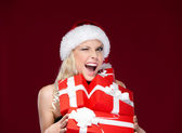 Pretty woman in Christmas cap holds a set of presents — Stock Photo