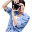 Creative lady-photographer takes shots - Stock Photo
