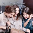 Girls admire the purchases of their friend — Stock Photo