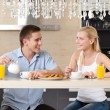 Stock Photo: Couple eats in the kitchen