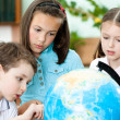 Stockfoto: Pupils stare at school globe