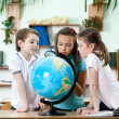 Stockfoto: Friends stare at school globe