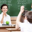 Stock Photo: Teacher questions pupils at algebra