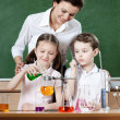 Stock Photo: Little pupils study chemical liquids