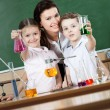 Little pupils learn chemistry — Stock Photo