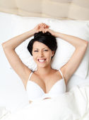 Sleeping woman in the spacious bed — Stock Photo