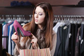 Woman wonders at excellent shoes — Stockfoto