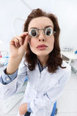 Trying on medical spectacles, serious — Stock Photo