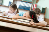 Sleeping at the desk — Stockfoto
