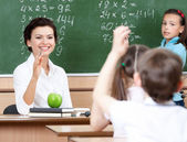 Teacher questions pupils at algebra — Stock Photo