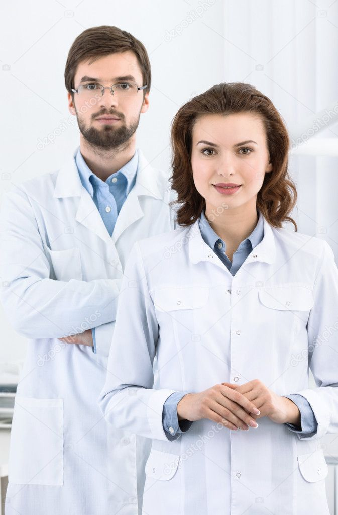 Dentist and his assistant are always ready to help to the patient, white background — Stock Photo #12416995