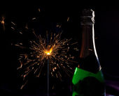 Champagne bottle and sparklers — Stock Photo