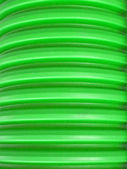 Abstract green large plastic rings, cable details. — Stock Photo