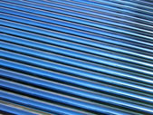 Blue glass tube heap, solar panel details. — Photo
