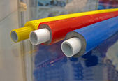 Few color plastic cables on transparent glass surface. — Stock Photo