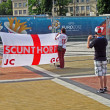 Sport fan making photo of England flag in Kiev, Ukraine. — Stock Photo
