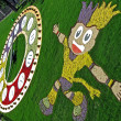 EURO 2012 talisman from flowers and green grass, clock in Kiev, Ukraine. — Stock Photo