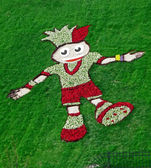 EURO 2012 talisman from flowers and green grass in Kiev, Ukraine. — Stock Photo