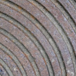 Abstract rusty metall surface with round rings, construction. — Stock Photo #11805259
