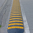 Abstract yellow stripped road barrier for cars on asphalt, security. — Stock Photo
