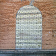 Foto Stock: Abstract brick stone window on stone wall, construction.