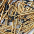 Stock Photo: Abstract carbonized wooden matches heap, stress environment.