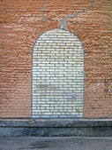 Abstract brick stone window on the stone wall, construction. — Stock Photo