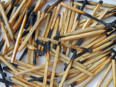 Abstract carbonized wooden matches heap, stress environment. — Stock Photo