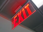 Exit sign inside of silver surface, security details. — Stock Photo