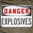 Stock Photo: Danger explosives, warning message on signboard.