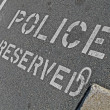 Police reserved as text on asphalt, security details. — Stock Photo
